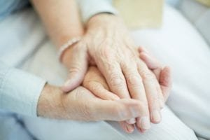 mesothelioma patients holding hands