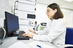 Researcher analyzing risk for peritoneal mesothelioma